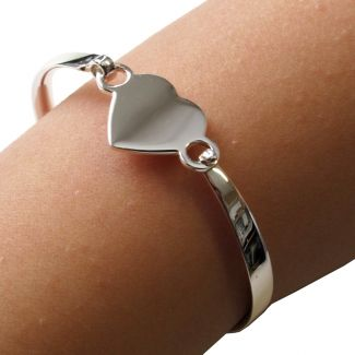 Childs Engraved Sterling Silver Heart ID Bracelet on arm